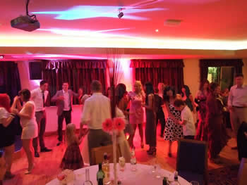 red venue lighting at Blackley Golf Club with guests dancing