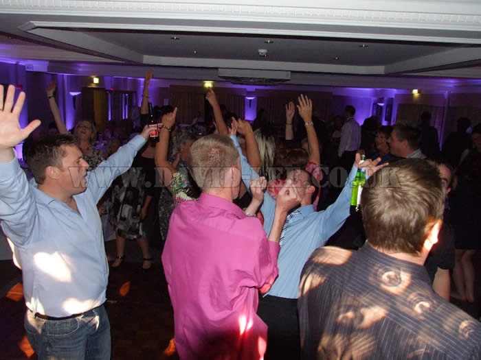 Wedding dj and guests at village hotel cheadle with purple up lighting