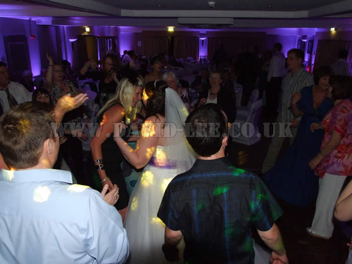 Purple uplighting with the bride dancing with friends in cheadle