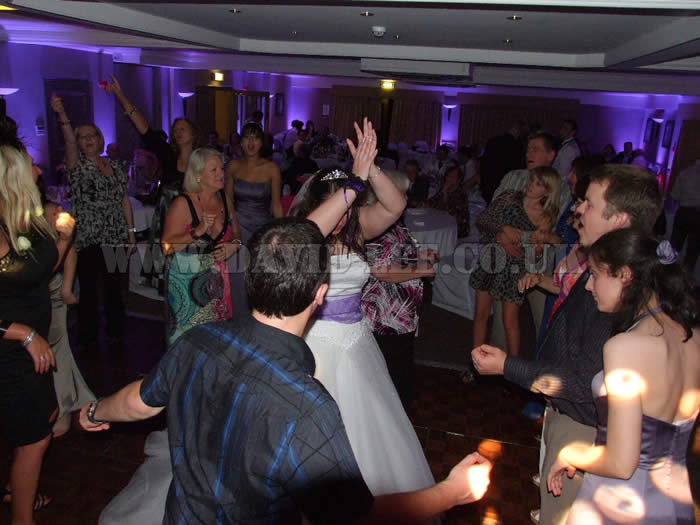 Bride dancing at village hotel cheadle with uplighting and dj