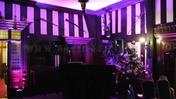 Bramall Hall wedding venue in pink venue lighting