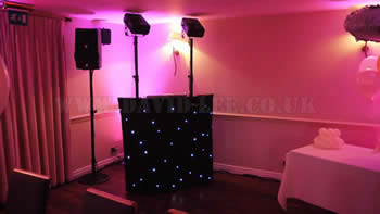pink venue lighting at white hart restaraunt with alternative disco set-up