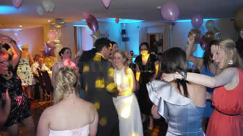 bride and groom dancing during the night