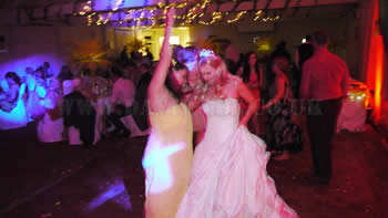Bride dancing with friends at Quarry Bank Mill wilmslow