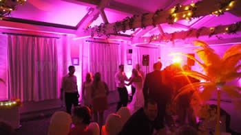 Pink  venue up lighting at Quarry Bank Mill wilmslow