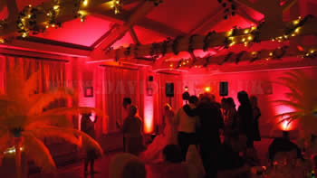 Quarry Bank Mill with red up-lighting with a wedding DJ