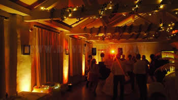 Quarry Bank Mill wilmslow with yellow venue up lighting