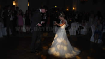 bRIDE AND GROOM dancing to their song on their wedding day